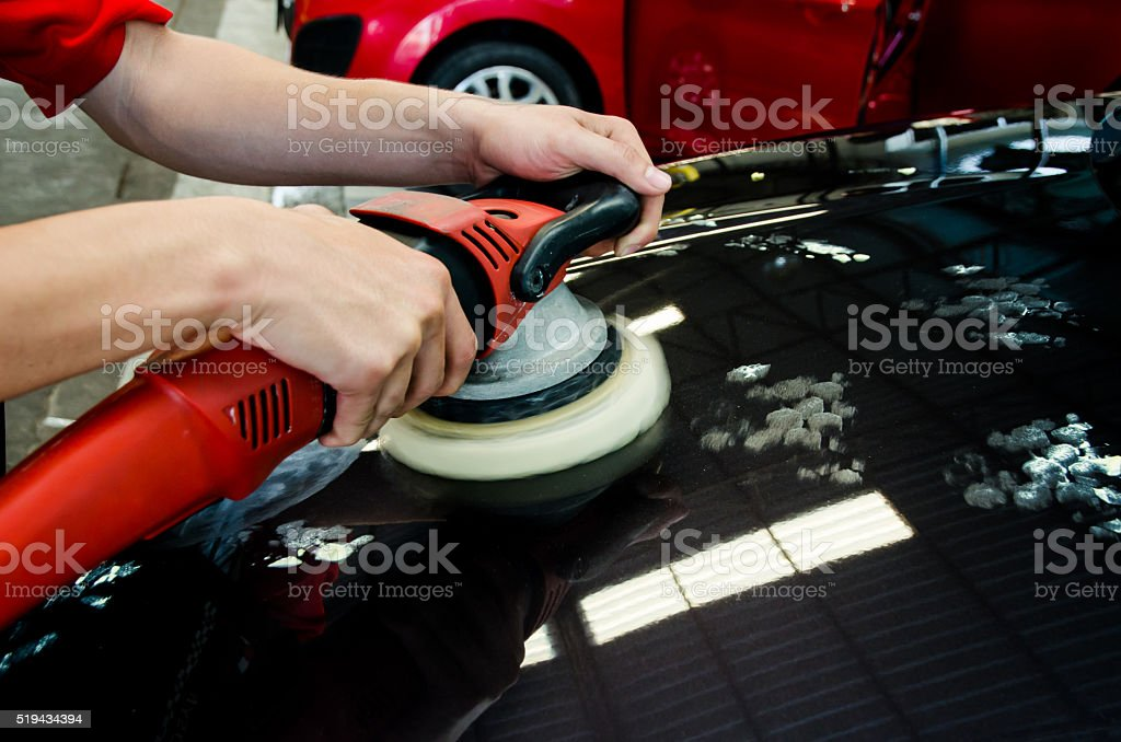 Hands with daul action polisher. polishing on car surface. hand stock photo