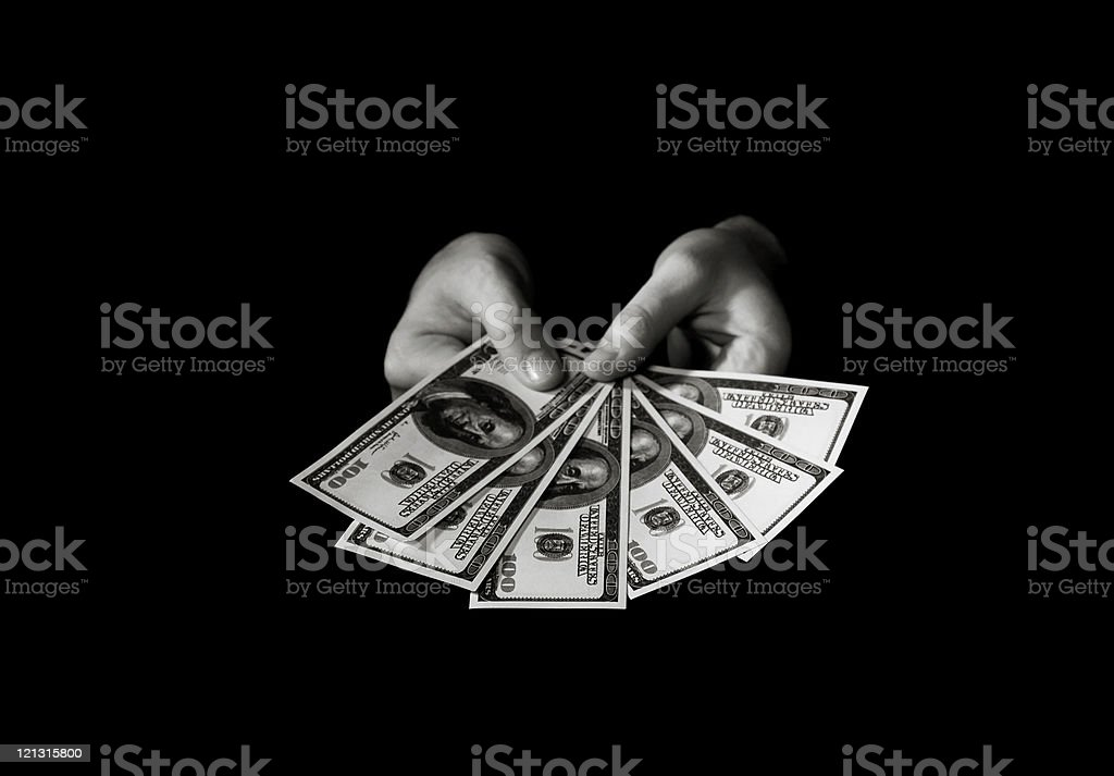 Hands with dollars over black royalty-free stock photo