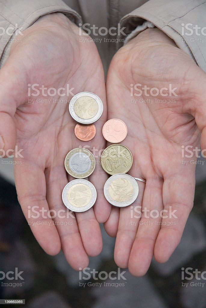 hands with euro coins royalty-free stock photo