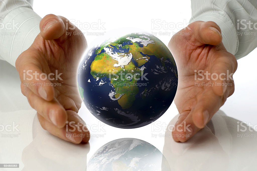 Hands with graphic of Earth hovering between royalty-free stock photo
