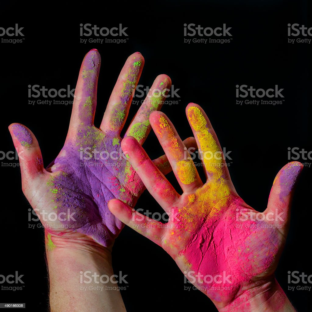 Hands with holi paint stock photo