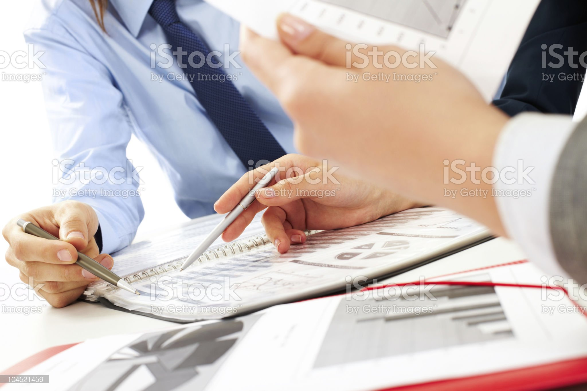 Hands with pens over business papers royalty-free stock photo