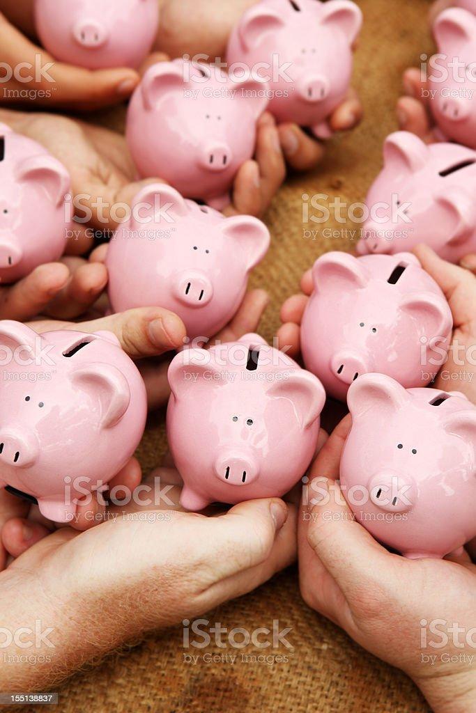 Hands with Piggybanks stock photo