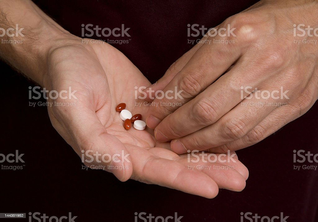 Hands with pills royalty-free stock photo