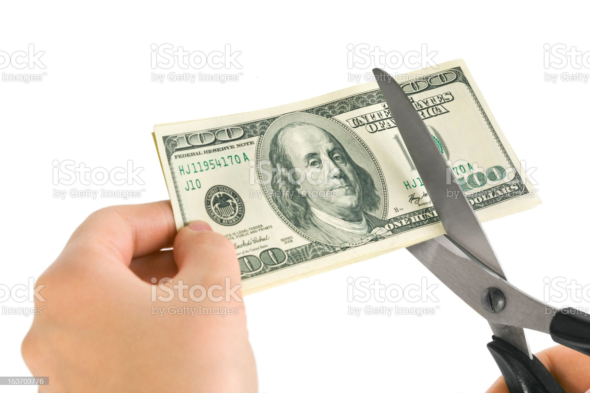 Hands with scissors cutting money royalty-free stock photo