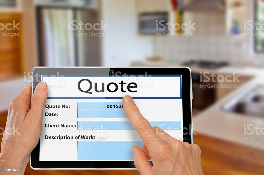 Hands with Tablet Kitchen Renovation Quote stock photo
