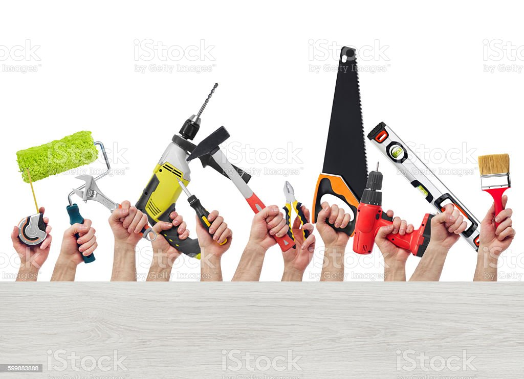 Hands with tools and wood board stock photo