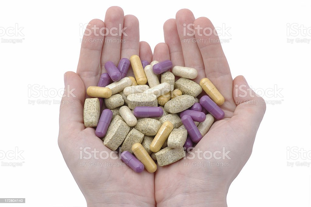 Hands with various kind of pills. Isolated on white royalty-free stock photo
