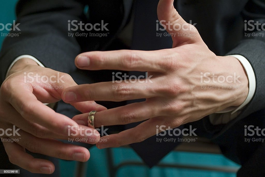 Hands with Wedding Band stock photo