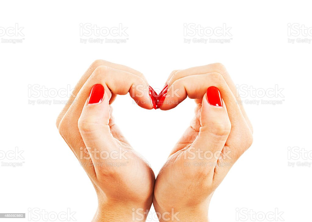 Hands with woman's professional red nails manicure stock photo