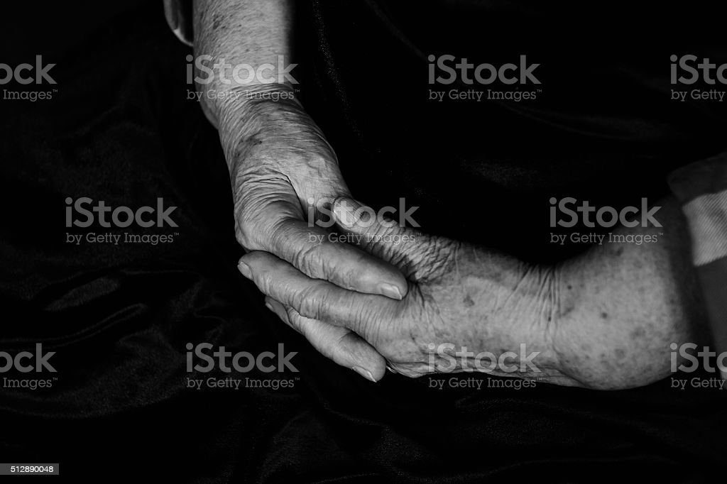 Hands with wrinkles old man stock photo