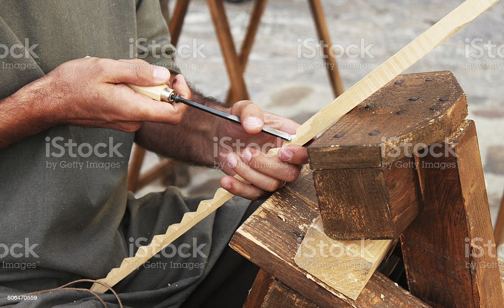 Hands wood carving royalty-free stock photo