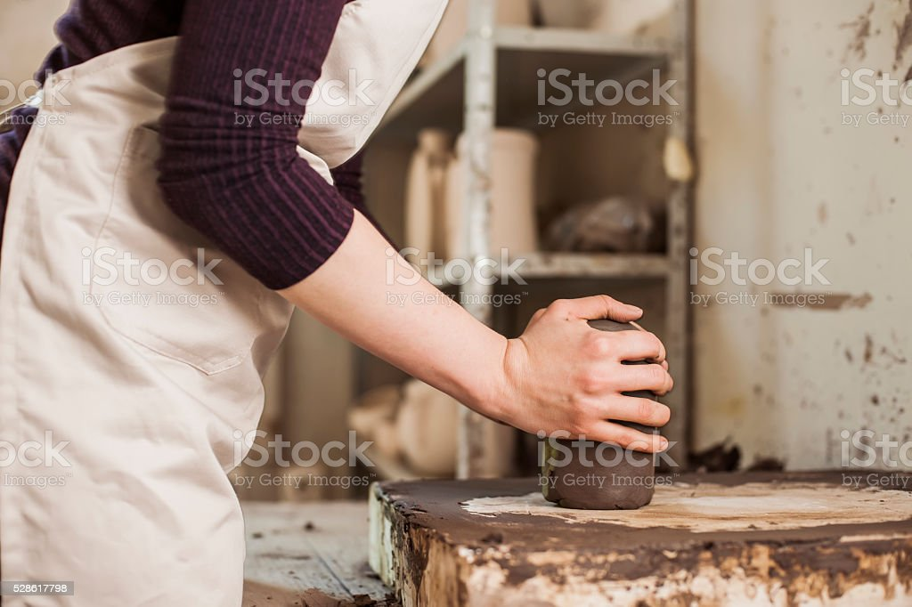 Hands working on clay's stock photo