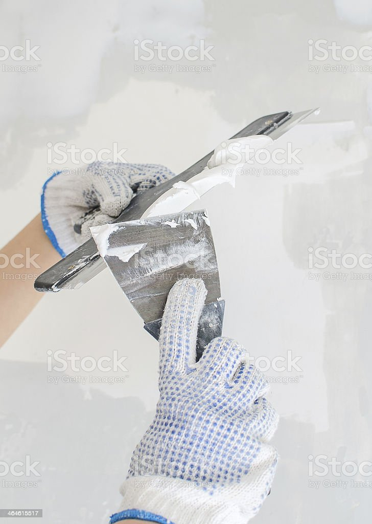 Hands working with spackling paste royalty-free stock photo
