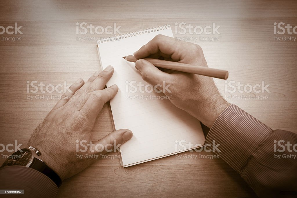 Hands writing a note stock photo