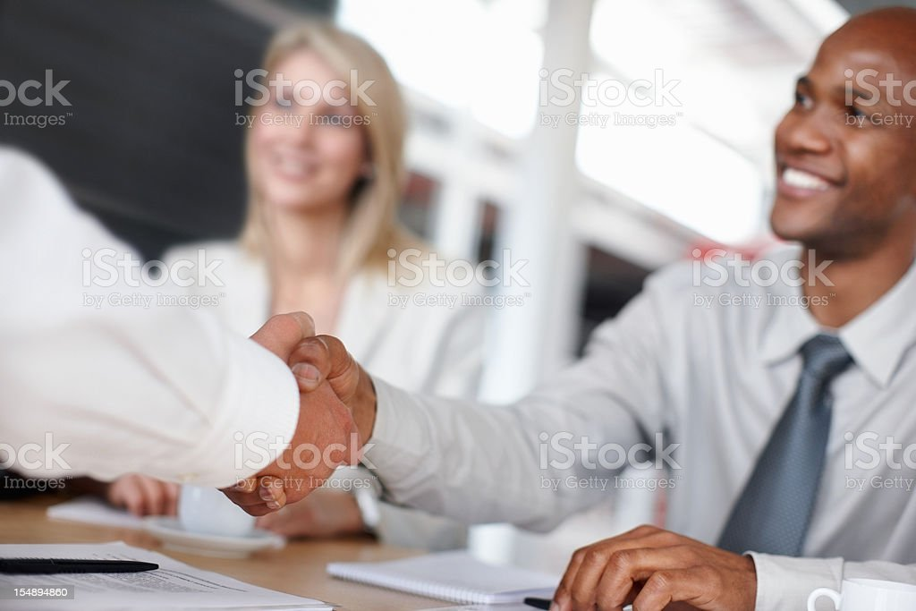 Handshake after a successful business meeting royalty-free stock photo