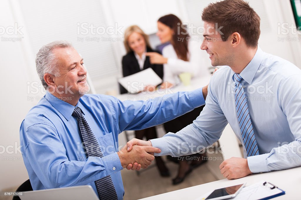Handshake after a successful business meeting. stock photo