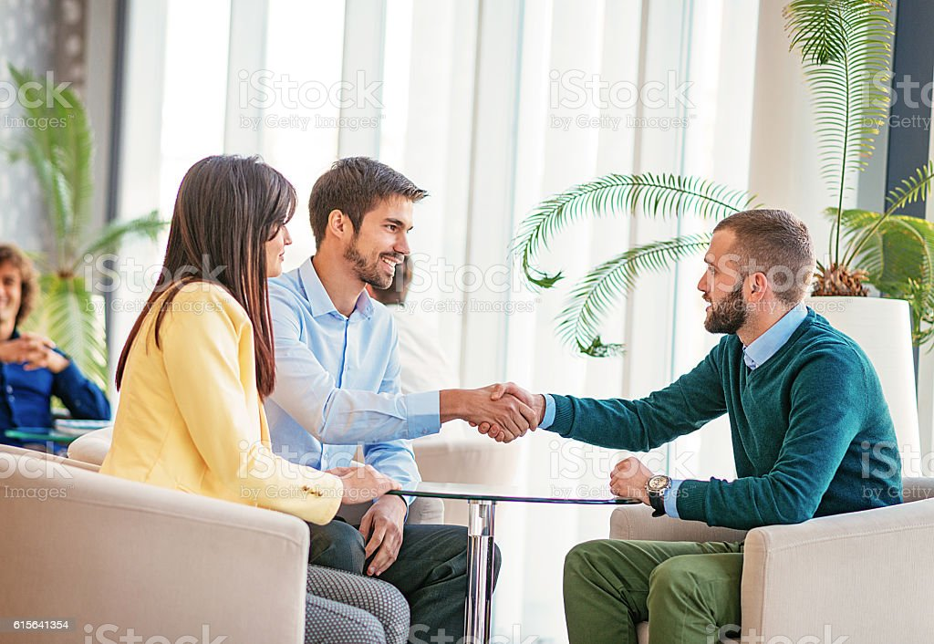 Handshake after successful meeting in Europe stock photo