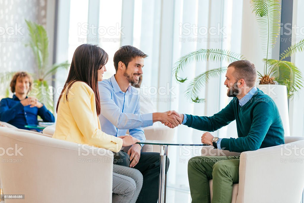 Handshake after successful meeting on conference stock photo