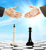 Handshake after the chess game. Concept of draw
