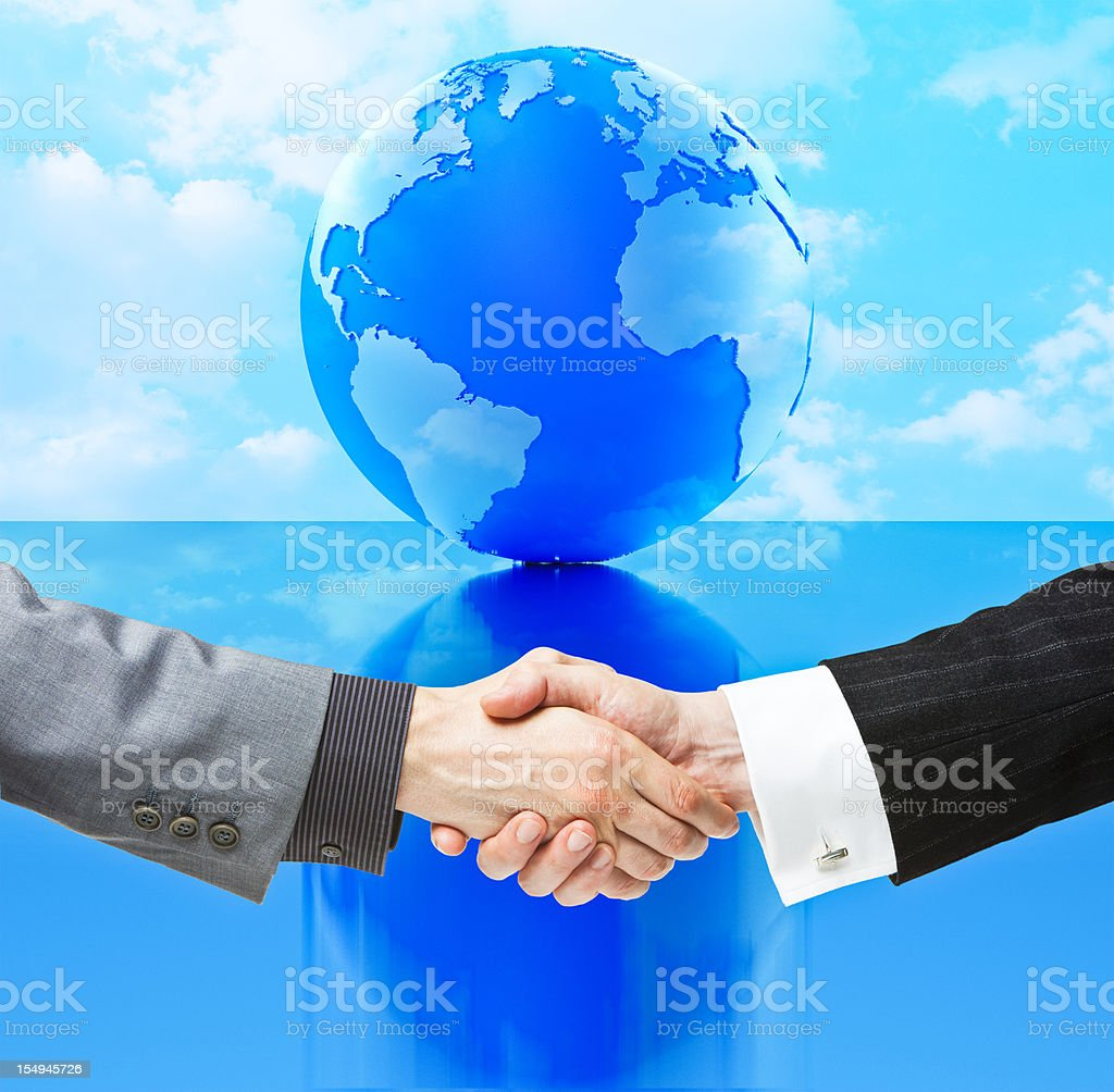 Handshake against Globe - Atlantic Version royalty-free stock photo