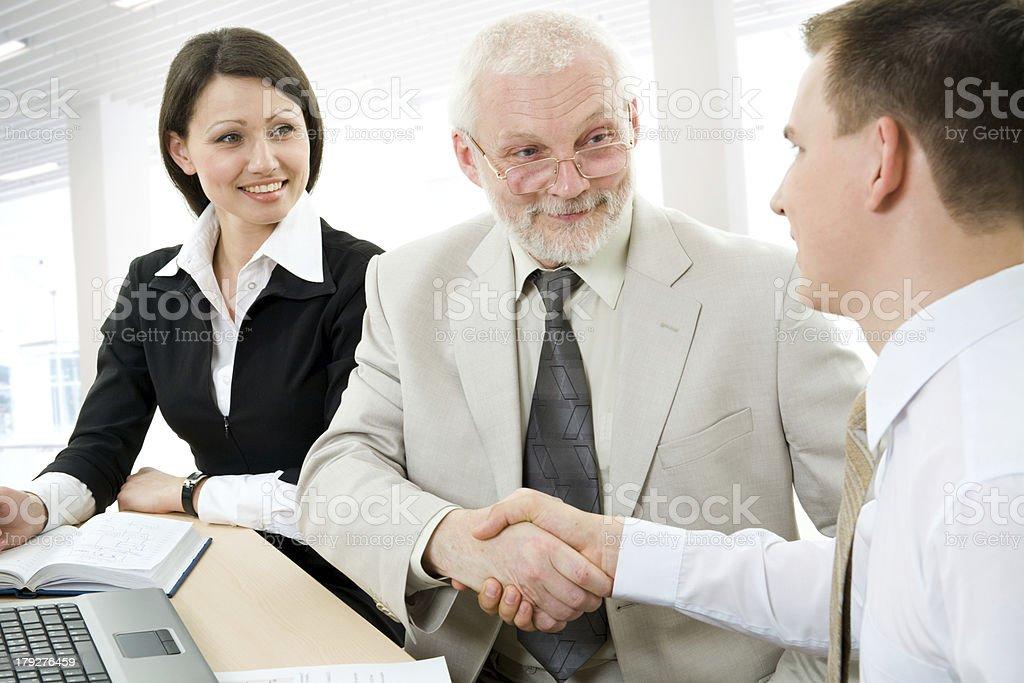 Handshake and teamwork royalty-free stock photo