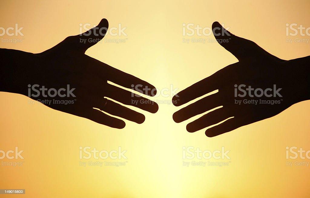 handshake at sunset royalty-free stock photo