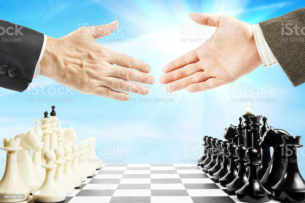Handshake before the chess game. Concept of fair play stock photo