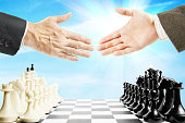 Handshake before the chess game. Concept of fair play