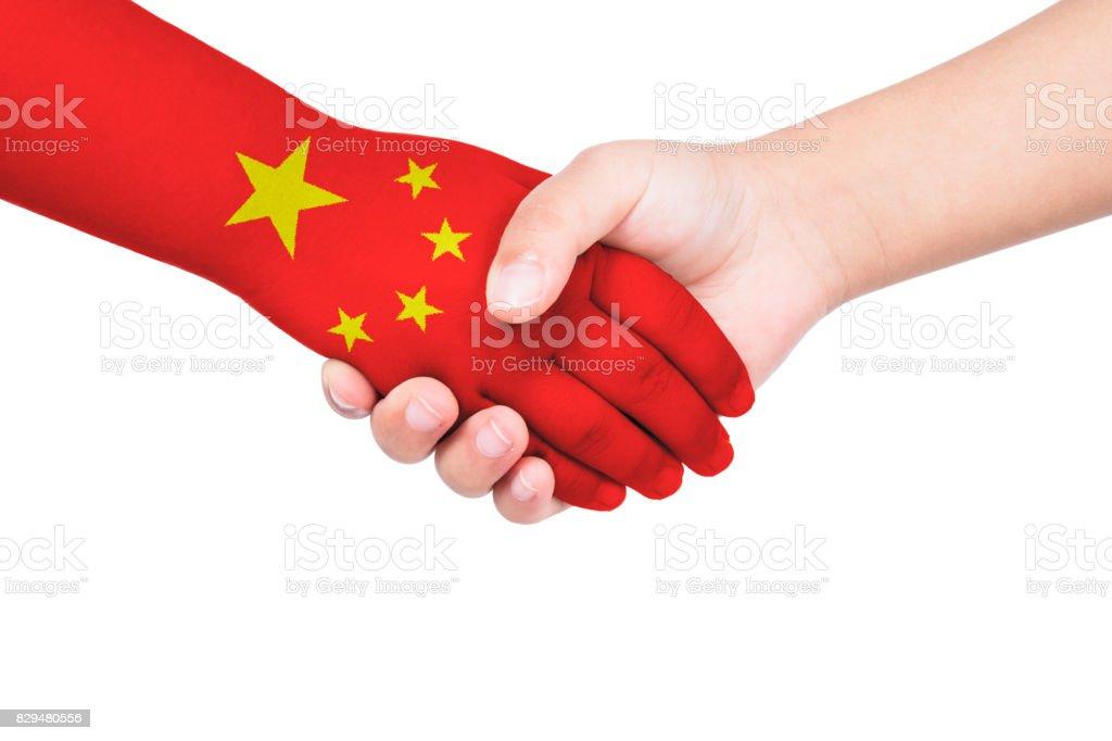Handshake between a child and China stock photo