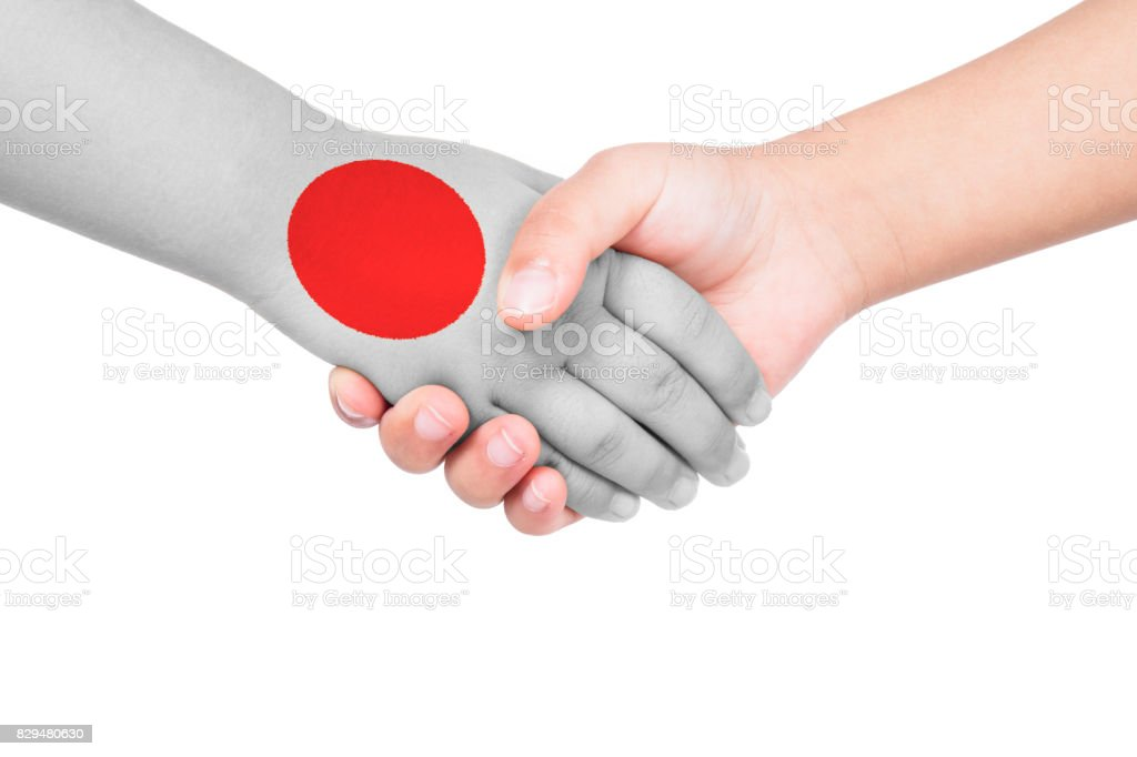 Handshake between a child and Japan stock photo