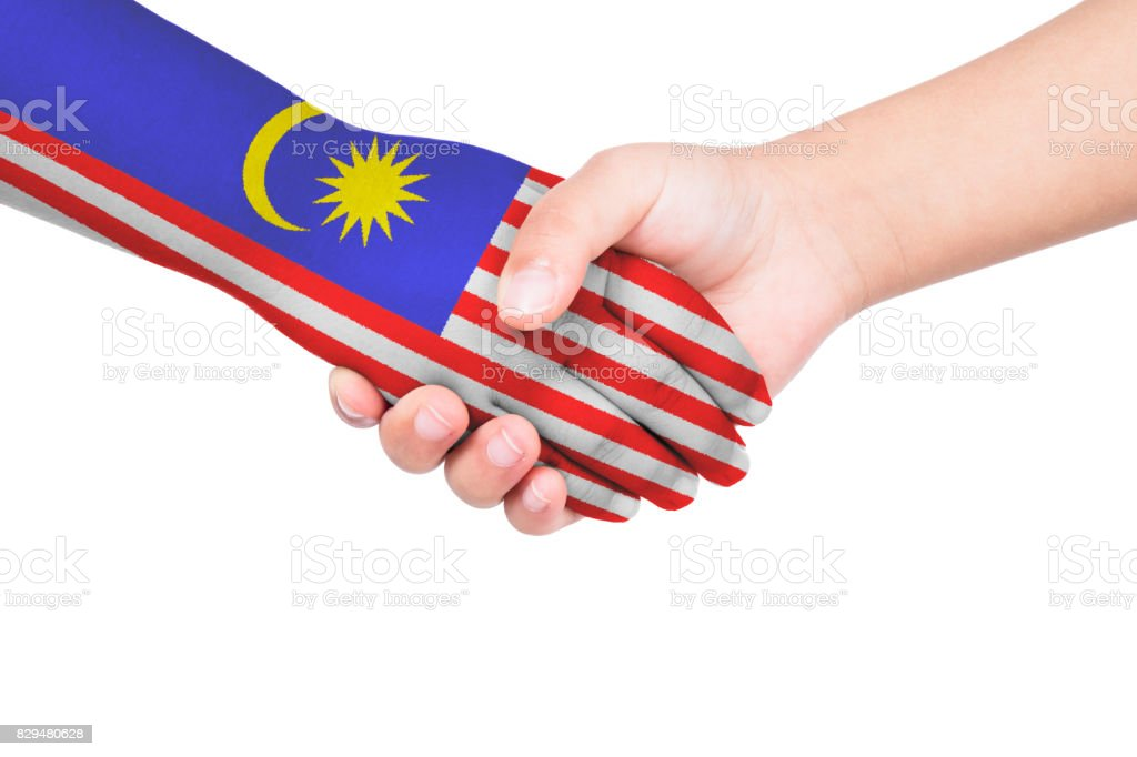 Handshake between a child and Malaysia stock photo