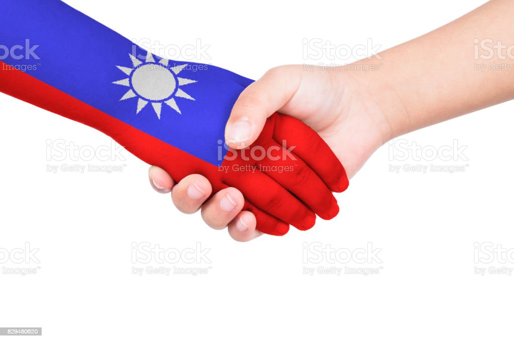 Handshake between a child and Taiwan stock photo