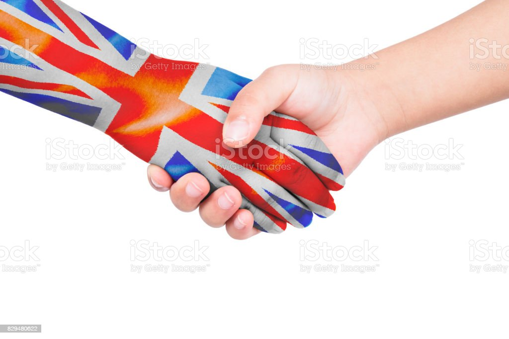 Handshake between a child and United Kingdom stock photo