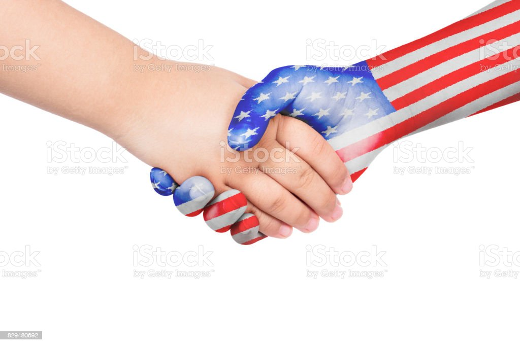 Handshake between a child and United States of America stock photo