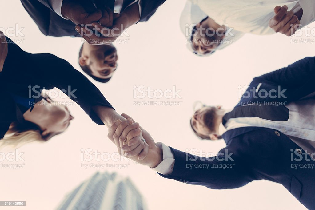 Handshake between business executives stock photo