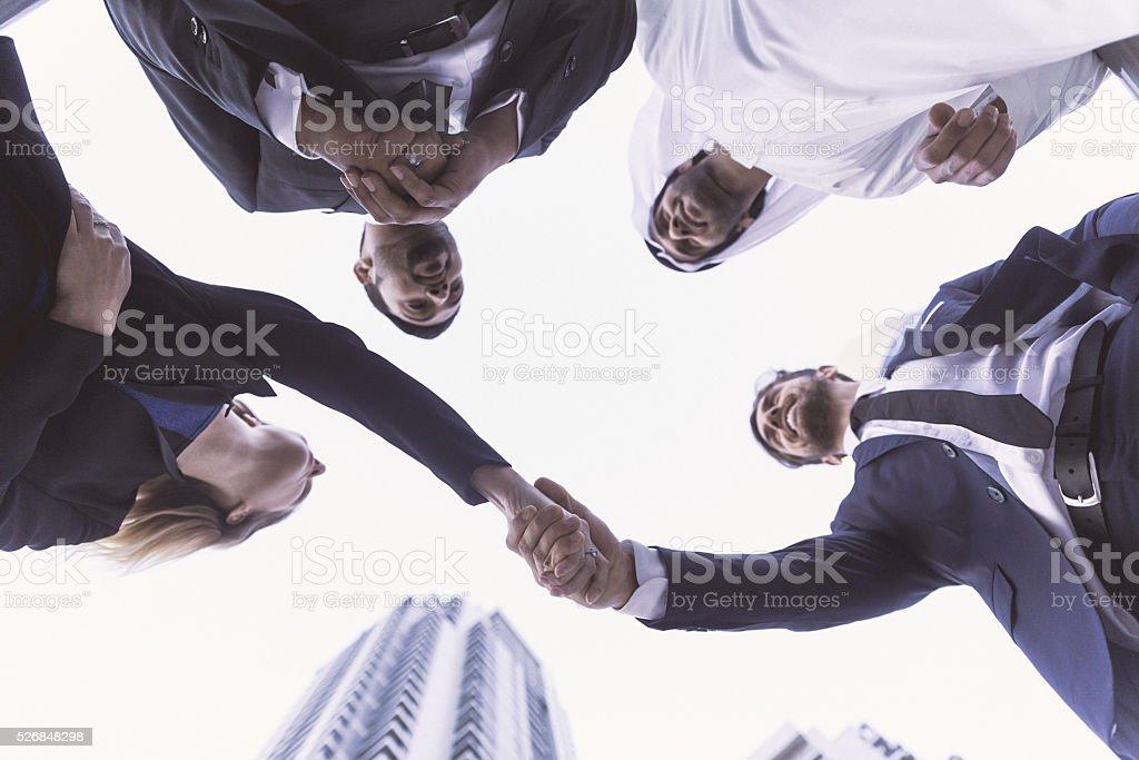 Handshake between business executives stock photo