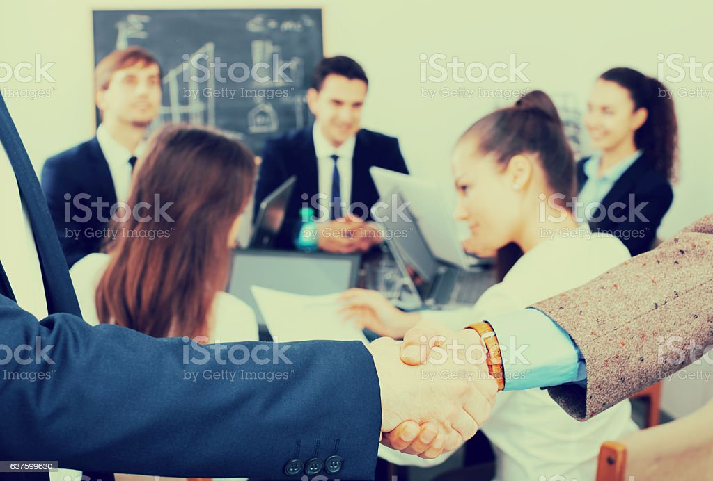 Handshake between business partners stock photo