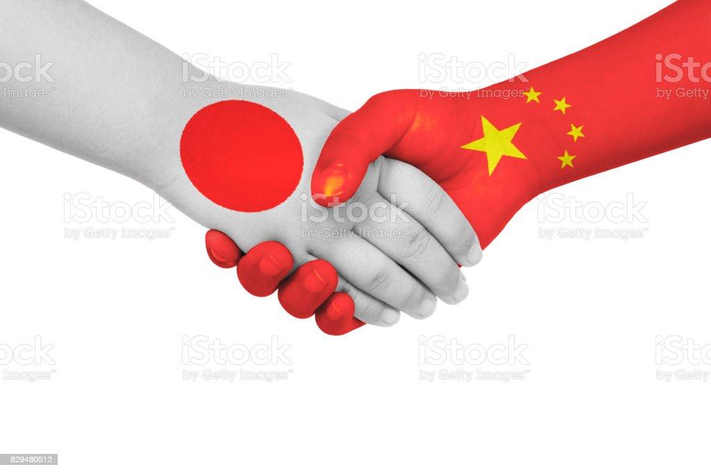 Handshake between China and Japan stock photo