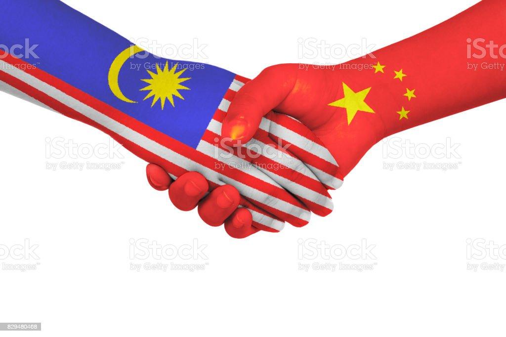 Handshake between China and Malaysia stock photo