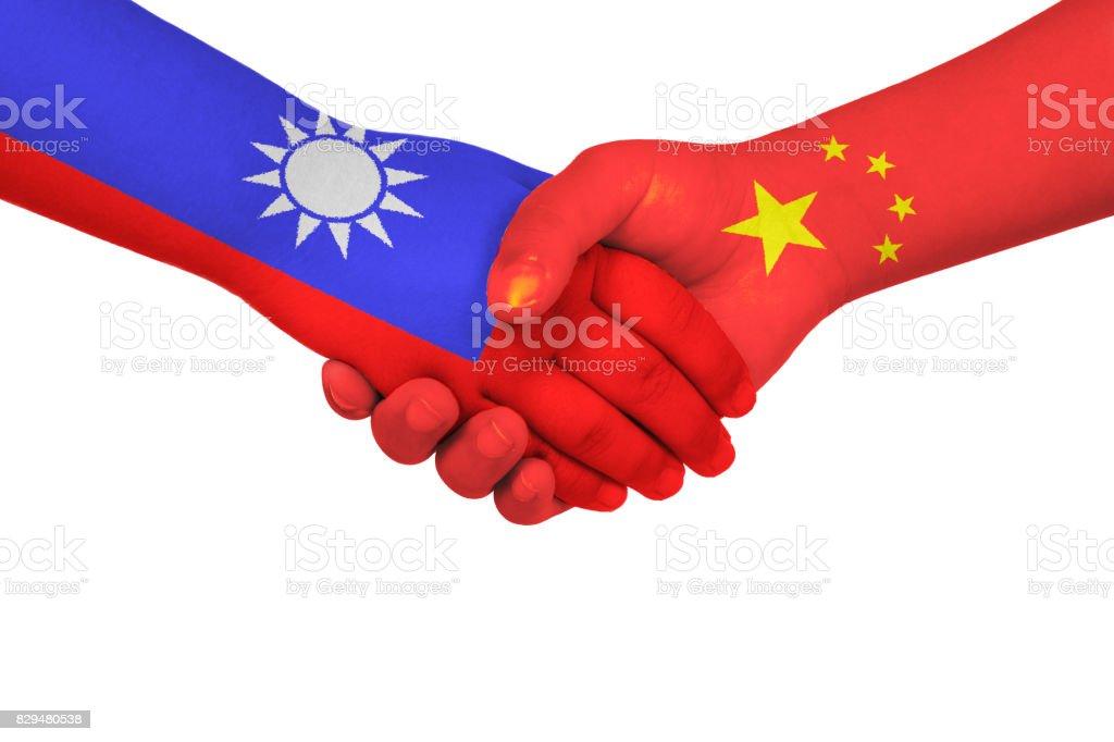 Handshake between China and Taiwan stock photo