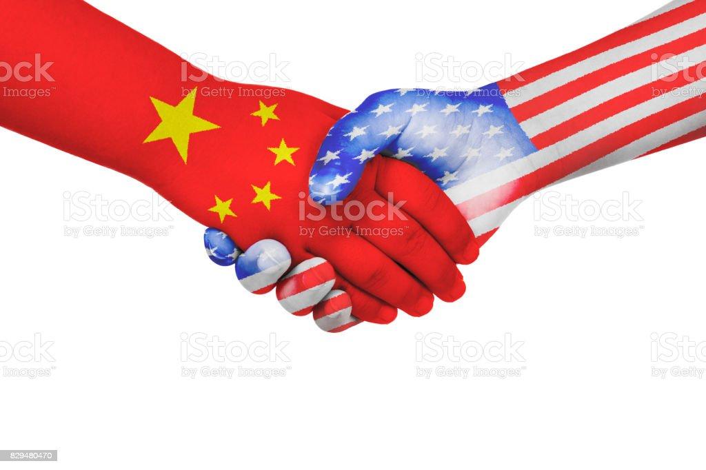 Handshake between China and United States of America stock photo