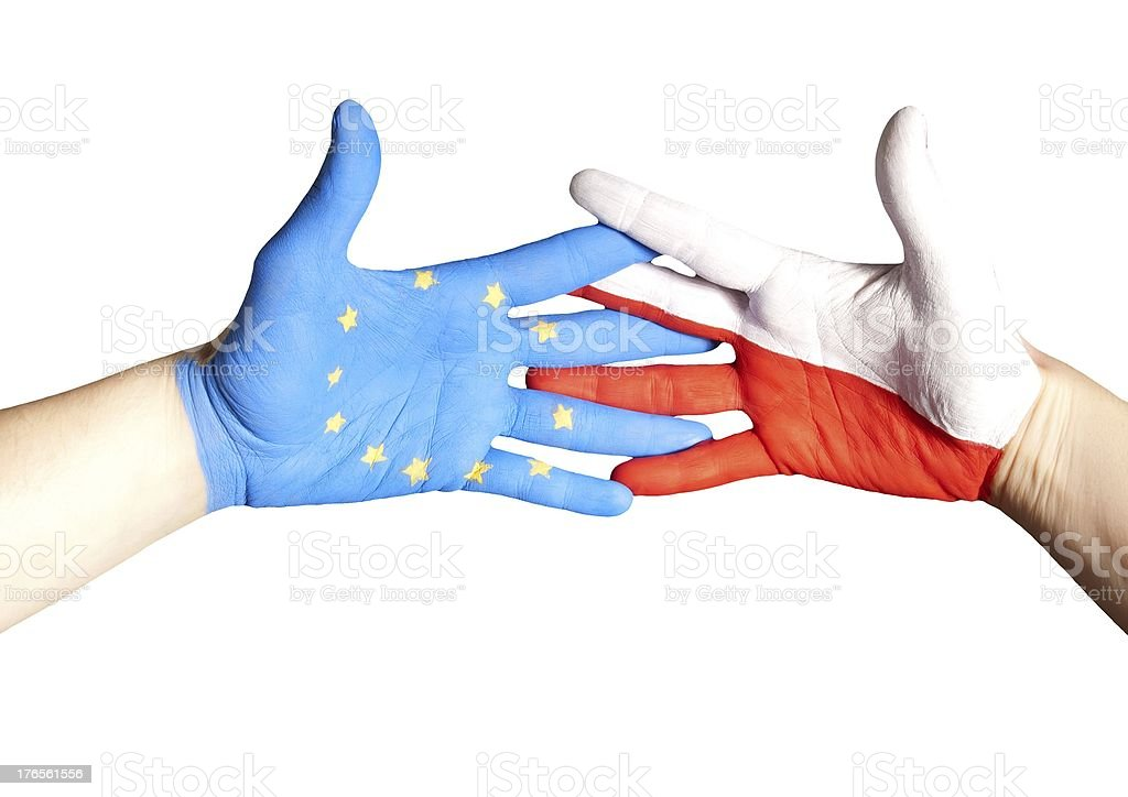 handshake between europe and poland royalty-free stock photo