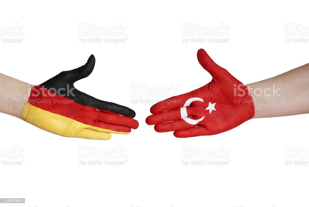 handshake between germany and turkey royalty-free stock photo