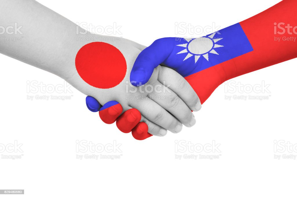 Handshake between Japan and Taiwan stock photo