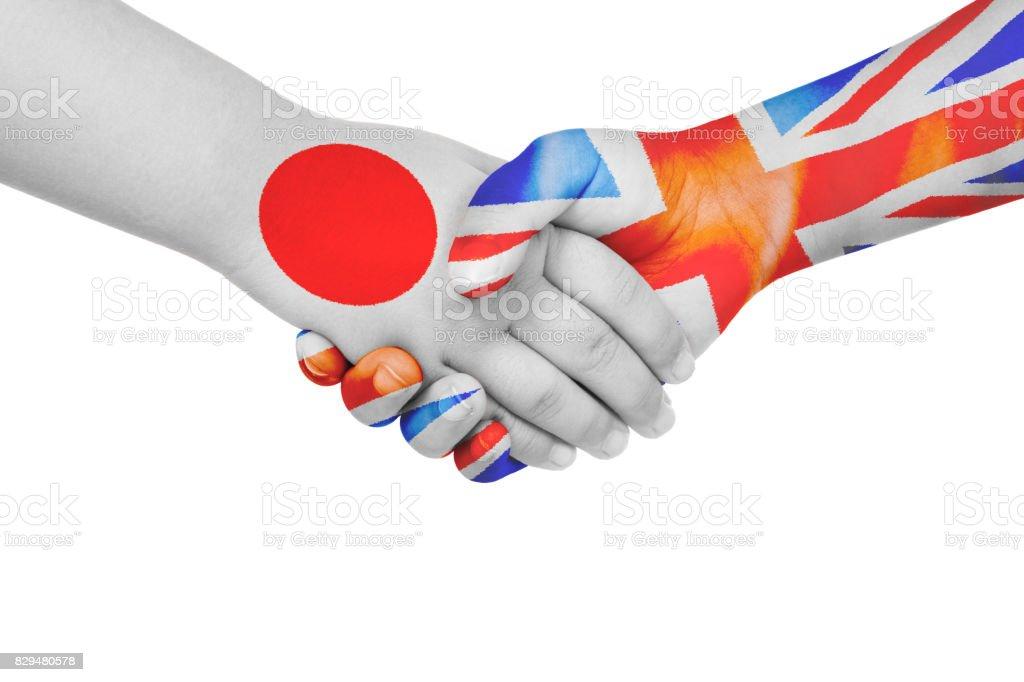 Handshake between Japan and United Kingdom stock photo