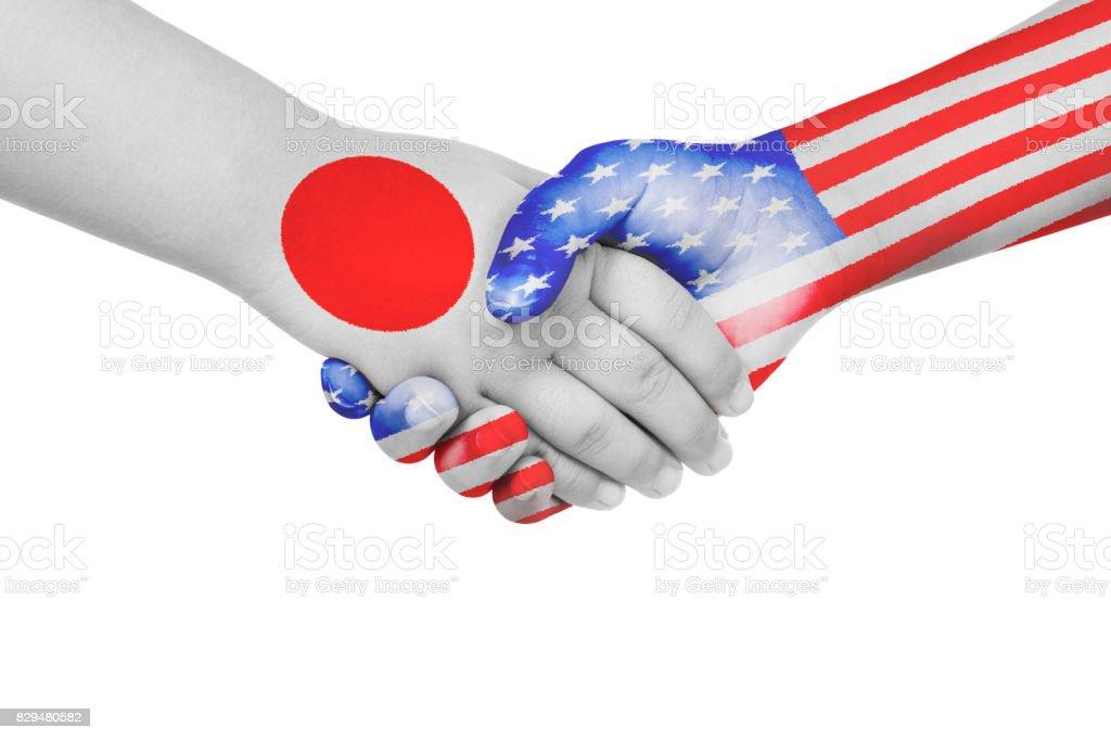 Handshake between  Japan and United States of America stock photo