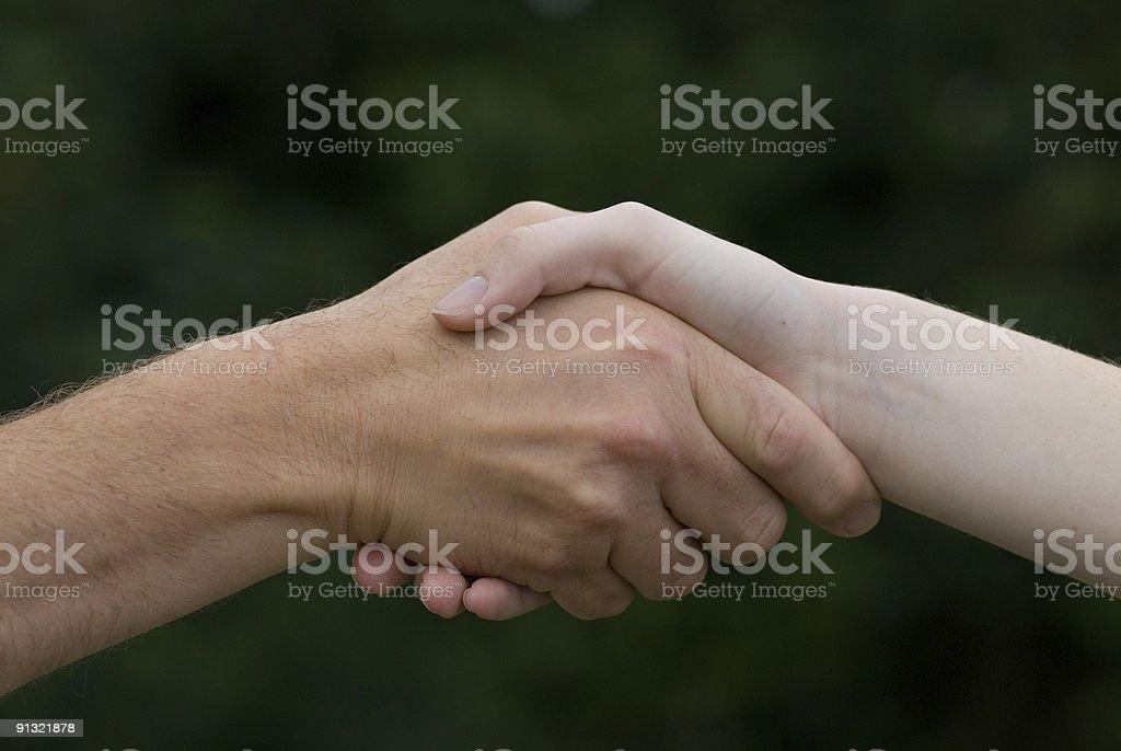 Handshake between man and women royalty-free stock photo