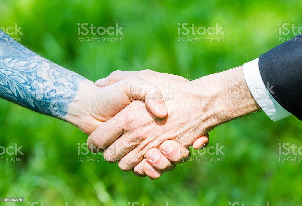 Handshake business and tattoo royalty-free stock photo