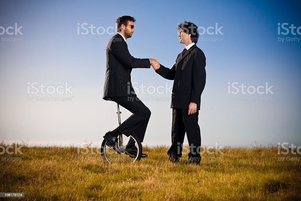 handshake business in the field royalty-free stock photo